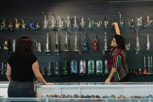 Owner Rachel Gulick helping customer at House of Glass in Des Moines, Iowa